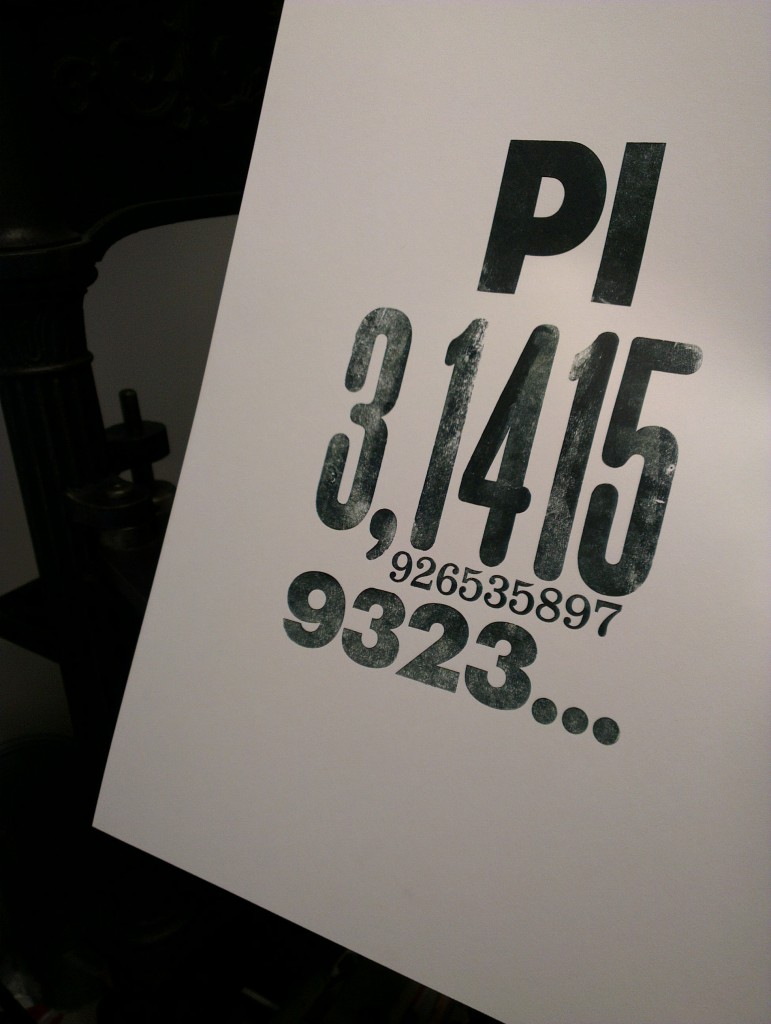 Some of the number pi printed on an old letterpress.